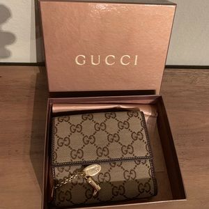 Gucci wallet with charms